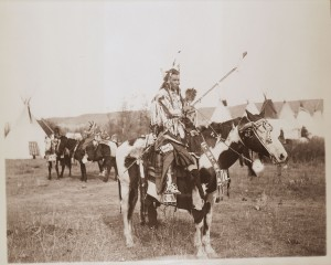 Fred_E._Miller-Spotted_Rabbit_(Crow_tribe)_on_horseback,_Montana